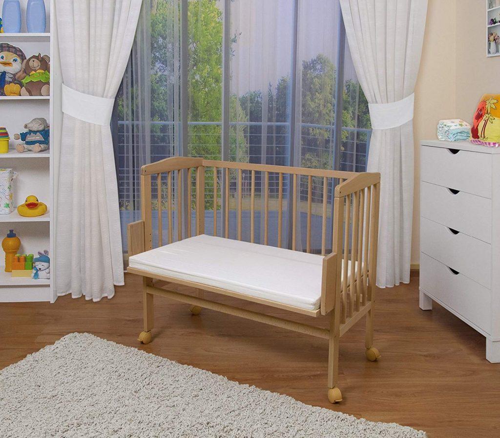 Le lit en bois co-sleeping Waldin propose une extension pour s'adapter à la majeure partie des lits.